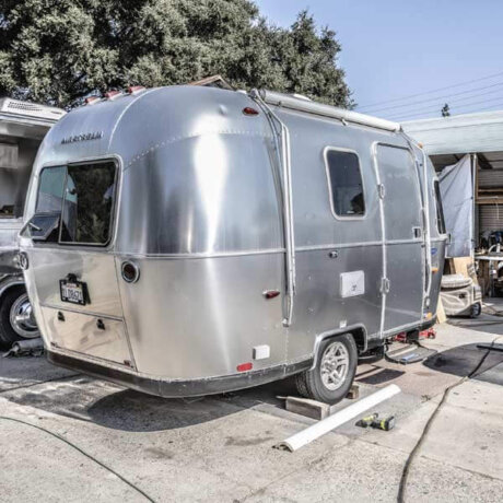 A sweet little Airstream trailer - all polished and ready to travel. Airstream trailer from the outside - showing off that iconic Airstream polished shine.