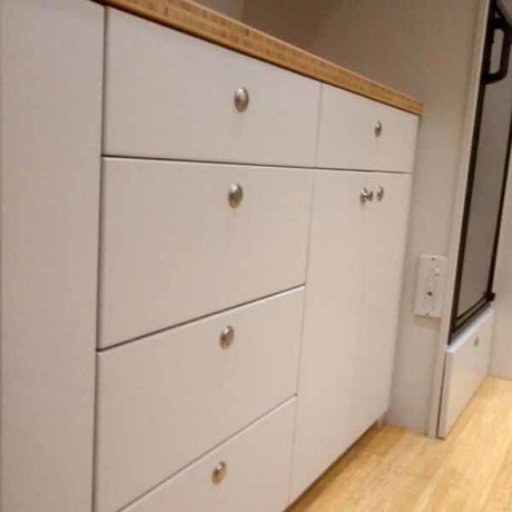 With this unit, we installed pull-out drawers with push-button knobs and fossilized Bamboo hardwood flooring.
