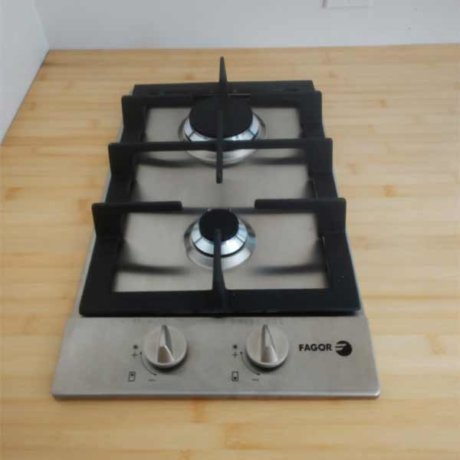 Fagor Products right here. We put in a 2-burner gas stovetop with electric ignitor over a bamboo countertop.